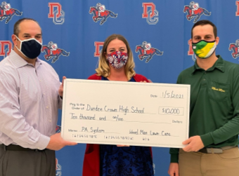 Weed Man Lawn Care Donates $10,000 to Dundee-Crown High School